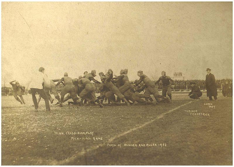 "Fielding Yost used the term ""Michigan Man"" in speeches. Yost on the sideline at right coaching the University of Michigan's 1902 football team against Minnesota."