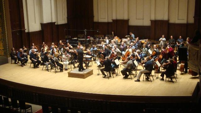 The Detroit Symphony Orchestra rehearses on stage