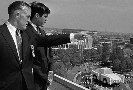 George W. Romney with son, Mitt, overlooking the Chrysler exhibit at the New York World's Fair grounds on May 18, 1964.