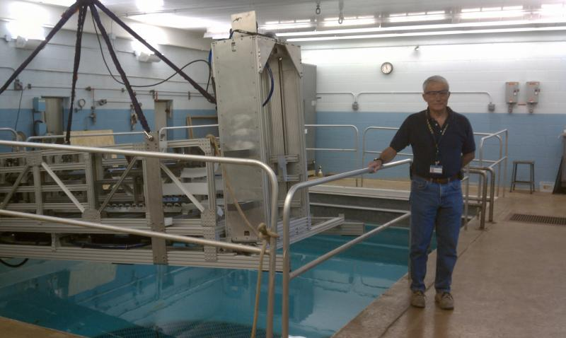 Woody Cook, Battelle National Security, next to a pool that is used to test underwater robotic devices.