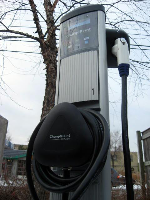 An electric vehicle charging station at a cafe in Grand Rapids that was purchased through the federal American Recovery and Reinvestment Act.