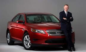Alan Mulally with one of his company's cars