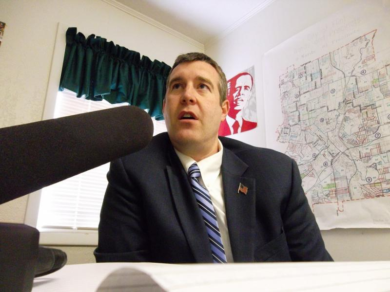 Flint mayor Dayne Walling responds to a question during an interview with Michigan Radio at his campaign headquarters