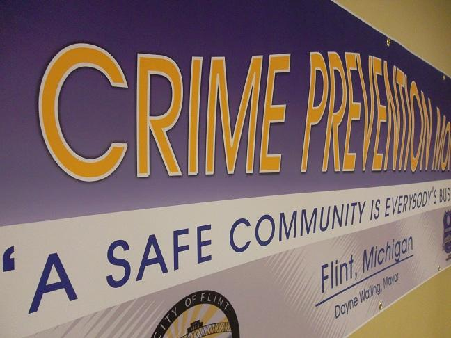 A banner hanging at last night's public meeting on gun violence in Flint