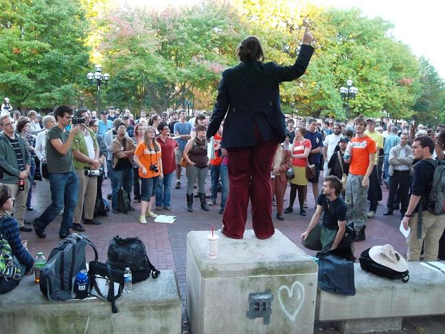 'Occupy Ann Arbor' organizer Whitney Miller addresses a growing crowd on the University of Michigan Diag