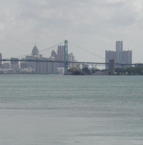 A view of downtown Detroit and the Ambassador Bridge from about a mile downstream, near the proposed site of the new international bridge.