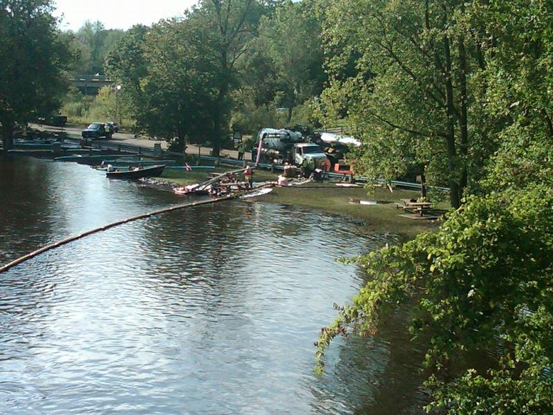 Cleanup crews work to remove oil from the Kalamazoo River near Battle Creek in August of 2010.