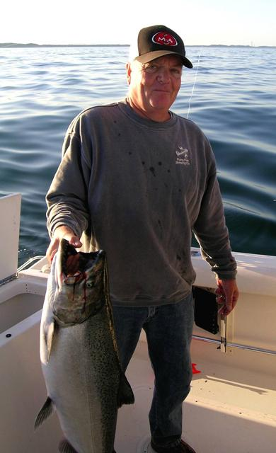 Dale Wilkinson with his salmon.