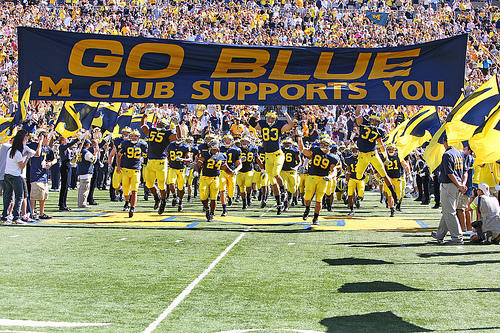 The Wolverines taking the field in 2009. They enter this season with 90-to-1 odds at the championship, but fans hope Harbaugh can turn them around.