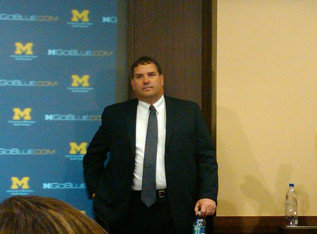 Brady Hoke awaits the media at his first press conference as Michigan's head coach earlier this year.