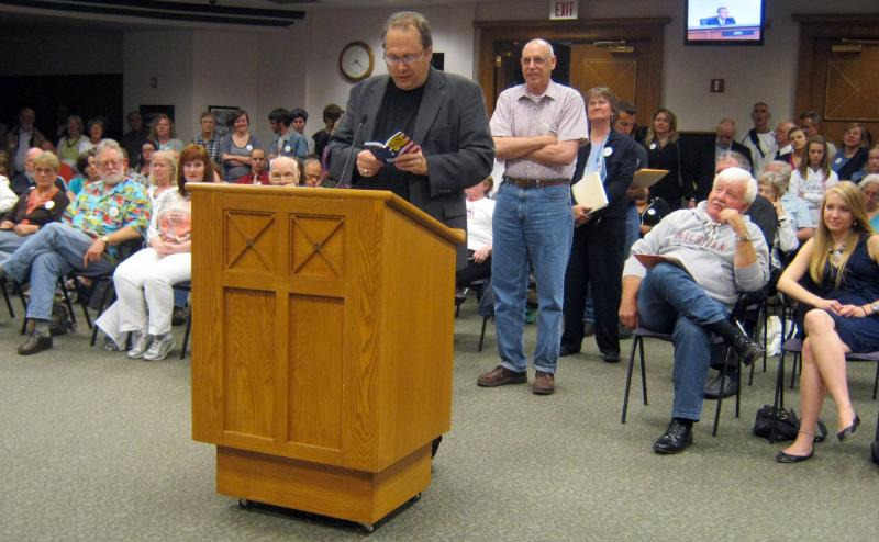 Rev. Bill Freeman reads from his copy of the U.S. Constitution during a packed public hearing on the proposed changes in June 2011. Freeman first requested city council to study the issue in the spring of 2010.