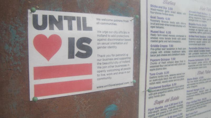 A small sign is posted outside The Piper Restaurant just outside Holland. The owner donated space and staff volunteered time for a fundraising gala for Until Love is Equal in October.