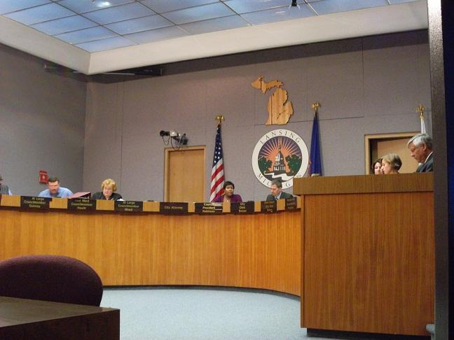 The Lansing city council discusses an issue during one of their 50 city charter required meetings this year