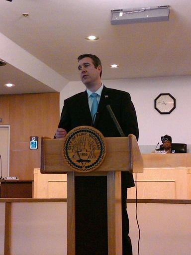 Flint mayor Dayne Walling addresses a city hall audience after being sworn in for his first full four year term