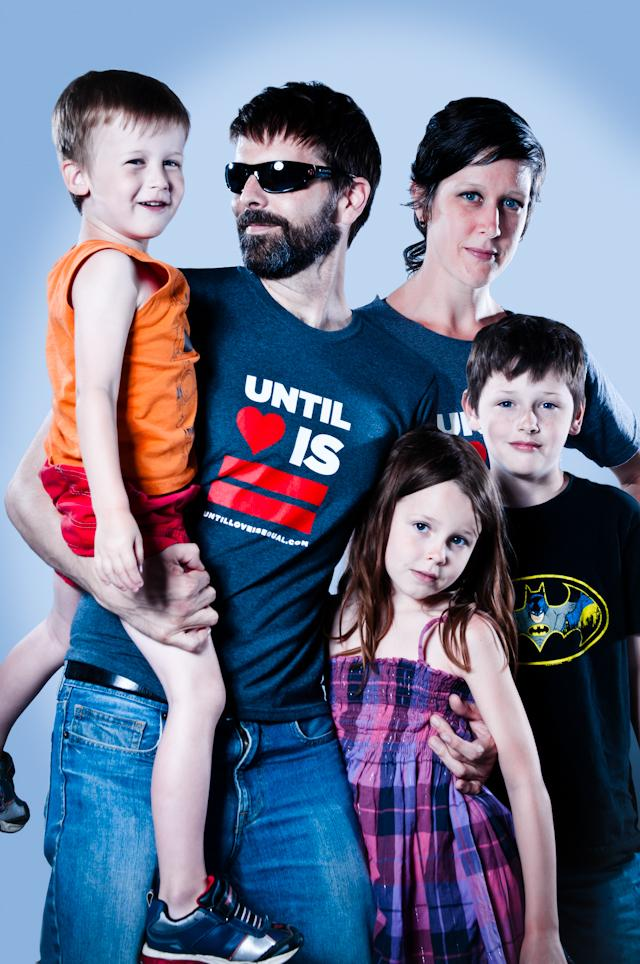 'Until Love is Equal' founder Erin Wilson holds his son Julian. Next to him are his wife Amy, son Riley and daughter Siona. The group sell t-shirts, sweatshirts and bumper stickers to raise awareness.