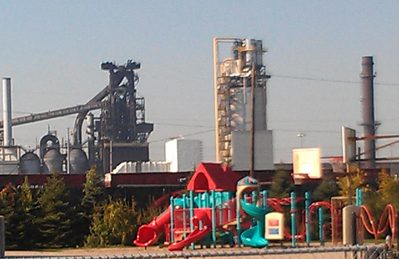 The playground at the Salina Elementary school in Dearborn with the Severstal steel plant in the background.