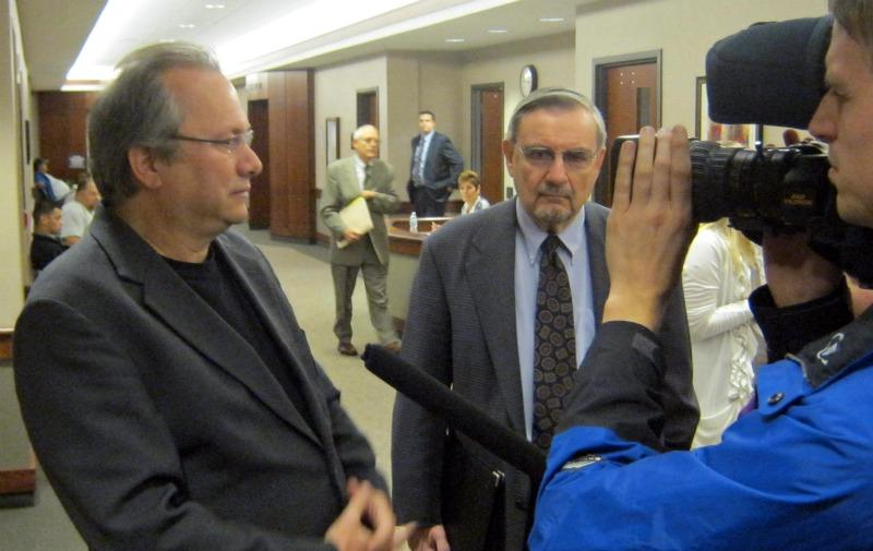 Rev. Bill Freeman (left) and his attorney Peter Armstrong Sr. (right) take questions from reporters after his brief court appearance Tuesday morning.