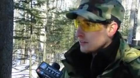 A Michigan militia member speaking with Rina Miller.