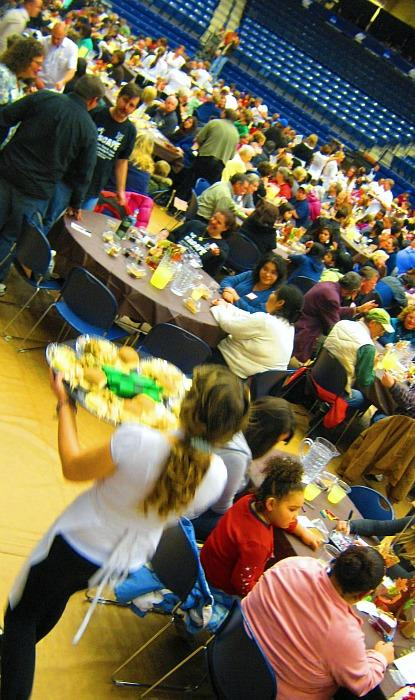 More than 1,300 people pack into Hope College's field house Wednesday night for the Great Thanksgiving Banquet.