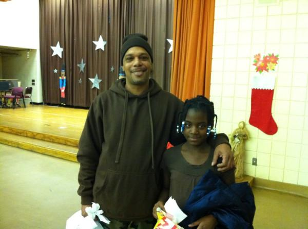 A father and daughter pick up a food basket in Detroit