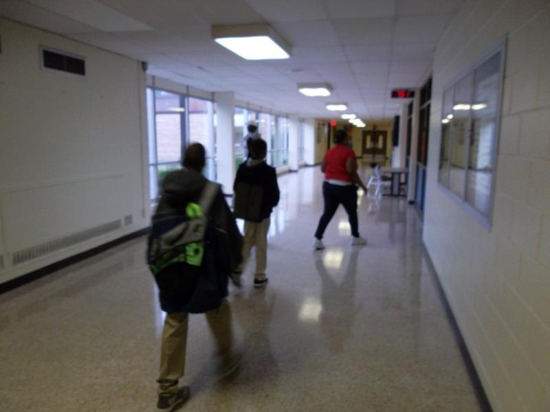 Lansing school children hurry to class
