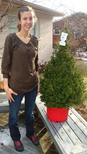Lauren and her potted tree. It will stay outdoors until Christmas Eve, when it will be brought in for 14 hours.