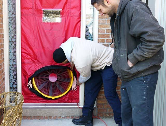 The team installs the blower door test.