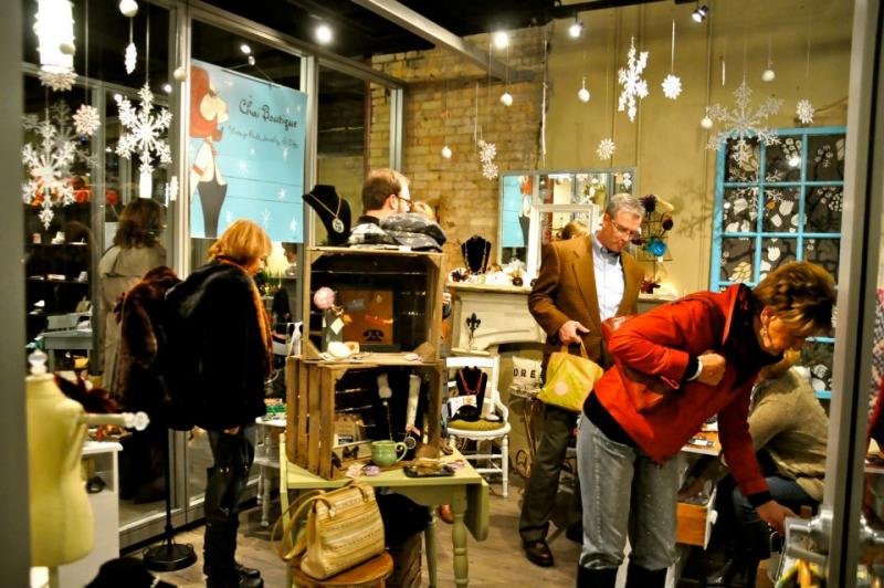 Shoppers in the 'cash-mob' check out the Shops at MoDiv, a retail incubator in downtown Grand Rapids.