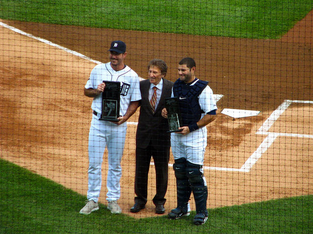 Justin Verlander was one of the good sports stories of the year. Photo - Verlander and Alex Avila receiving awards from Tigers owner Mike Ilitch.