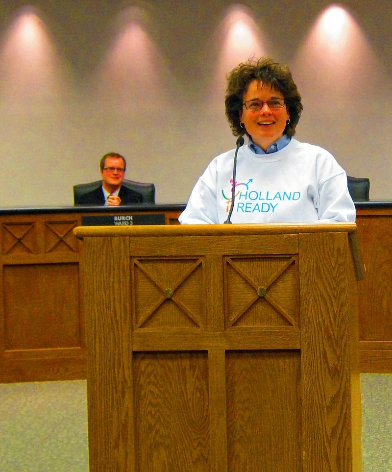 "Holland Is Ready leader Rev. Jen Adams accepts the City's Social Justice Award. ""We smile not only because there is a little humor here, but because there is also hope here,"" Adams said."