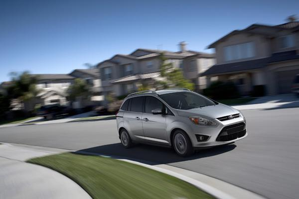 A Ford C-Max in a neighborhood.