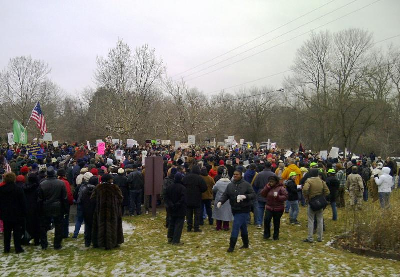 Protesters gather outside the gated community where Governor Snyder lives.