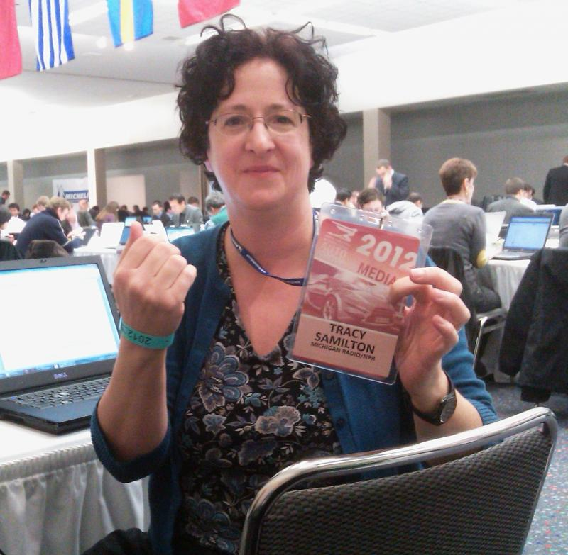 Michigan Radio Auto Reporter Tracy Samilton shows off her coveted credentials.