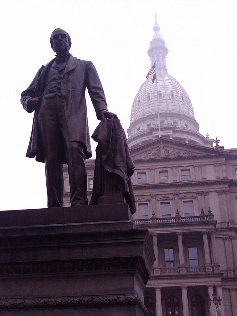 Statue of Gov. Austin Blair stands in front of the state capitol dome in Lansing
