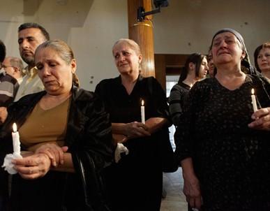 Iraqi Christians mourn following a 2010 attack on a Baghdad church that killed dozens