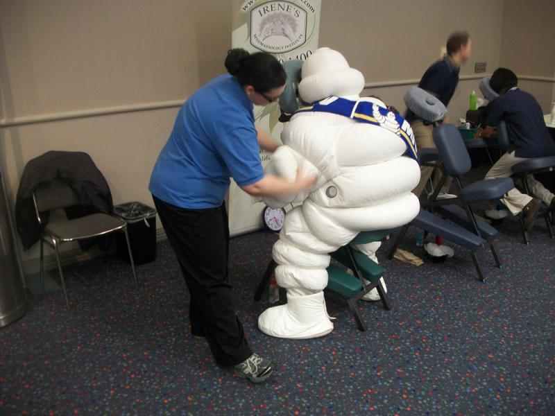 Michelin Man takes a break at the Detroit Auto Show for a chair massage.
