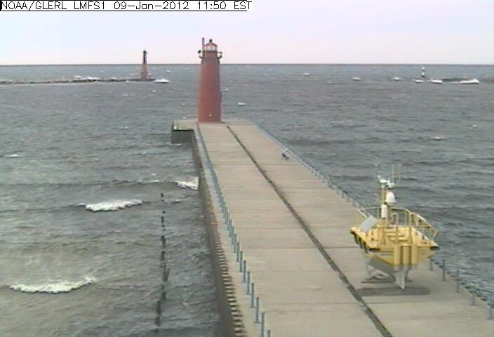 The yellow research buoy pictured by NOAA's live webcam on January 9th, 2012. The buoy will still collect wind data from this location before heading back out to the middle of Lake Michigan in early March.
