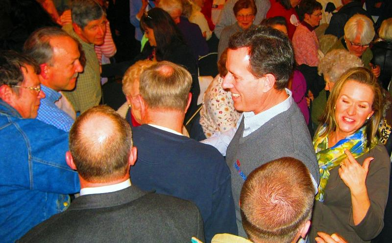 Santorum greets guests and signs autographs after the rally in Muskegon Monday.
