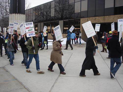 "Members of the Graduate Employees Organization picketing on the North Campus of the University of Michigan in 2008. Many University administrators and deans maintain these research assistants are not ""employees."""