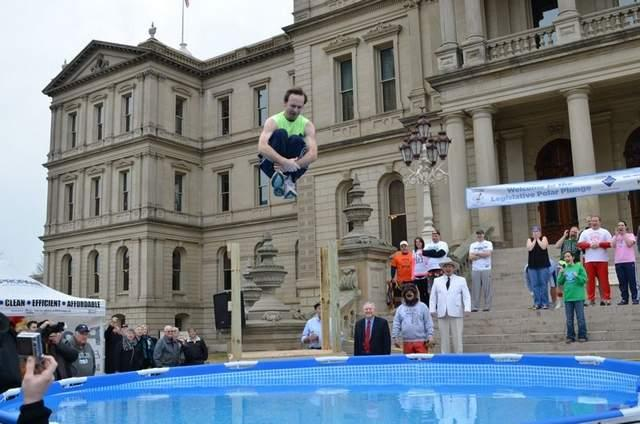 Lt. Gov. Brian Calley takes the polar plunge yesterday outside the Capitol building to raise money for Special Olympics Michigan