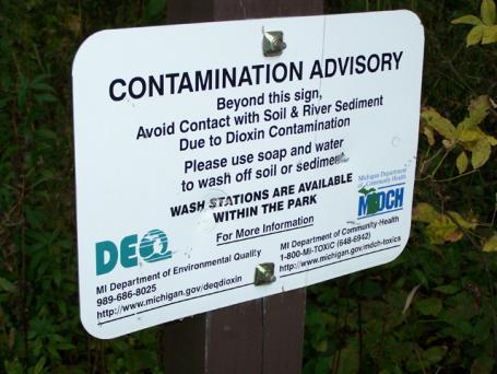 Imerman Park sits on the floodplain of the Tittabawassee River. Signs along the trail warn walkers about dioxin contamination in some of the park's soil.