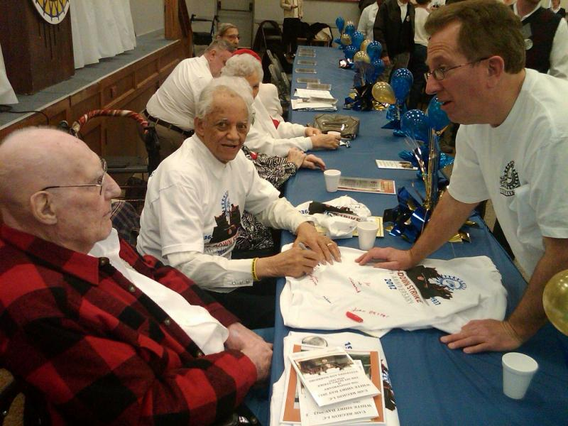 Surviving Flint Sit Down Strikers John Briggs (left) and James Todd (center) talk with one of the people who attended Friday's celebration of the 75th anniversary of the end of the sit down strike