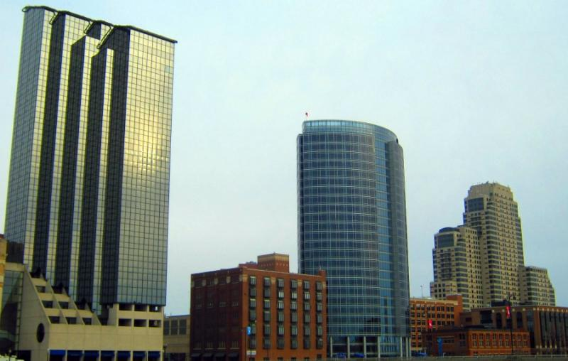 The Amway Grand Plaza, JW Marriott, and the Courtyard by Marriott hotels sit along the Grand River in Grand Rapids.