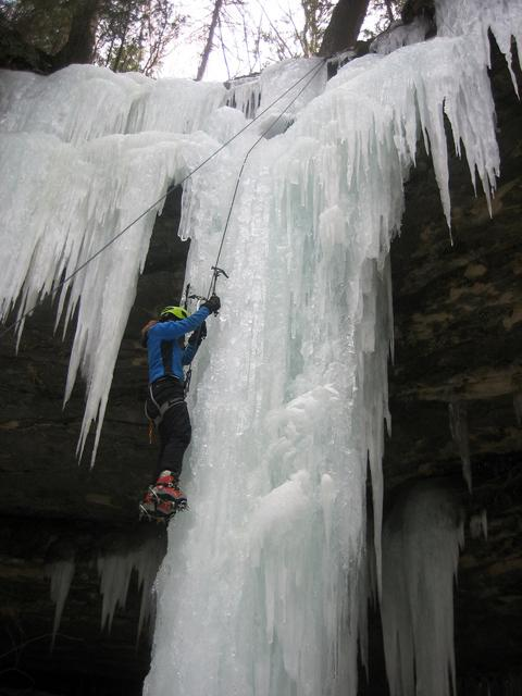 Meg Cramer climbs the left line. Warmer temperatures have softened the ice, and it's easy to sink in tools and crampons.