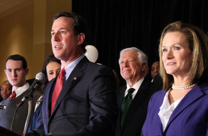 Rick Santorum celebrates his wins in Missouri, Minnesota and Colorado on Feb 7. Those wins gave him momentum in Michigan. Rival Mitt Romney says Santorum is going too far to try to get votes in Michigan.