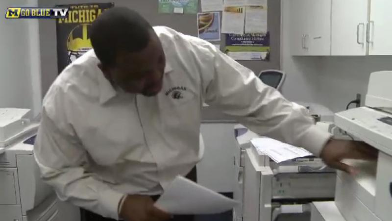 Chris Singeltary, the director of player personnel for the University of Michigan's football team, pulls the first signed letter of intent off the fax machine at 7:14 a.m. on National Signing Day.