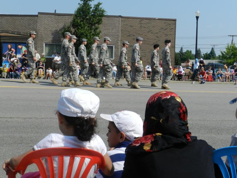 People watch as Dearborn's Memorial day parade passes by