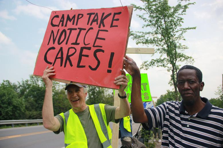 John Wagner (left) is a volunteer and supporter of Camp Take Notice. Alonzo Young is a camper. He's been attending classes at Washtenaw Community College.