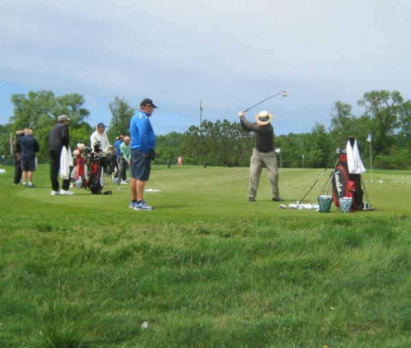 Professional golfers at the practice range at Harbor Shores this week.