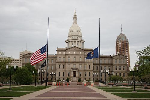 Flags at half mast in front of Michigan's state capitol building.